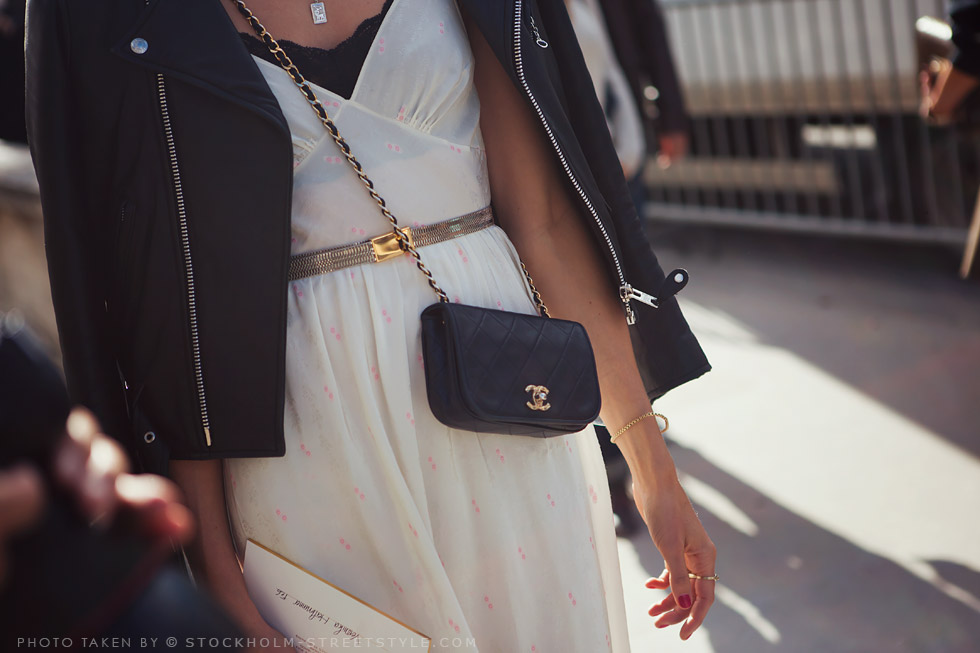 ñeather jacket and white dress