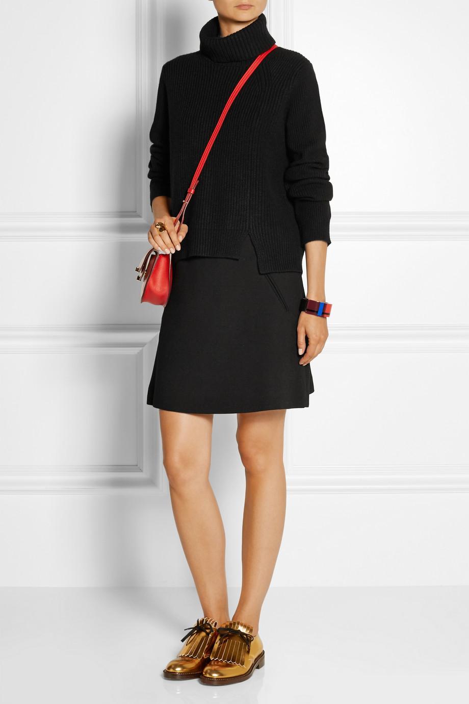 a turtleneck and mini skirt 2