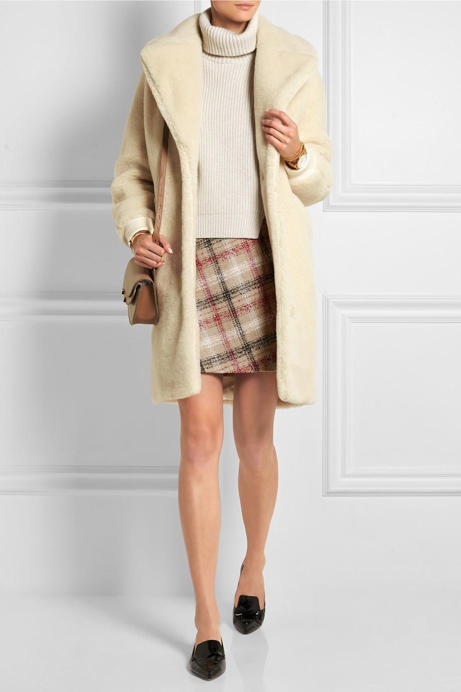 a turtleneck and mini skirt 3
