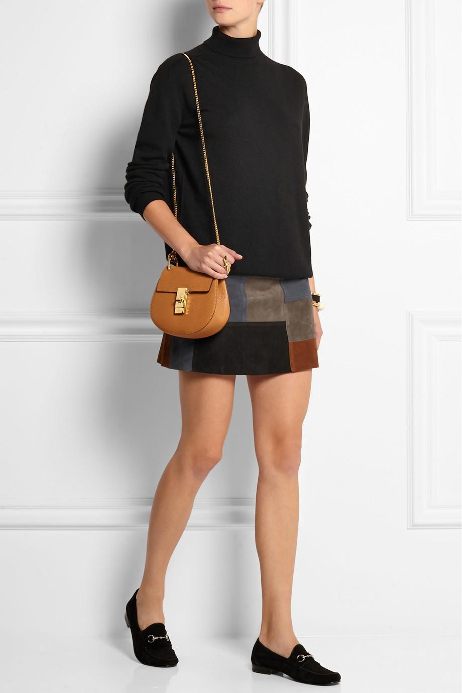 a turtleneck and mini skirt