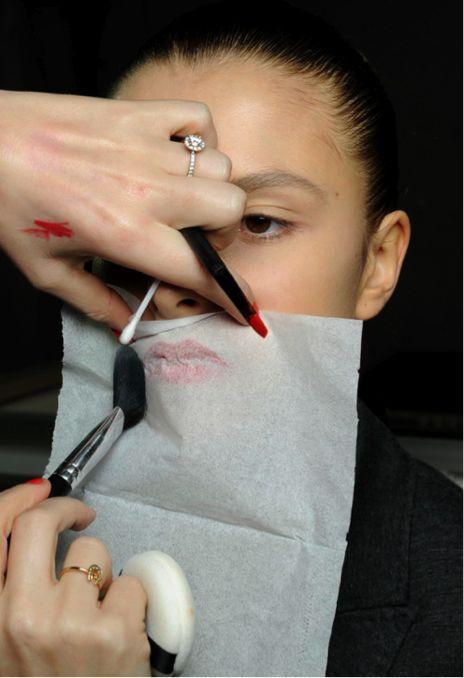 make up tip tissue over lips