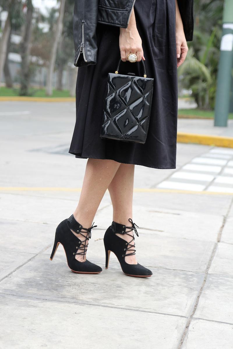 A line black skirt lace up black stilettos