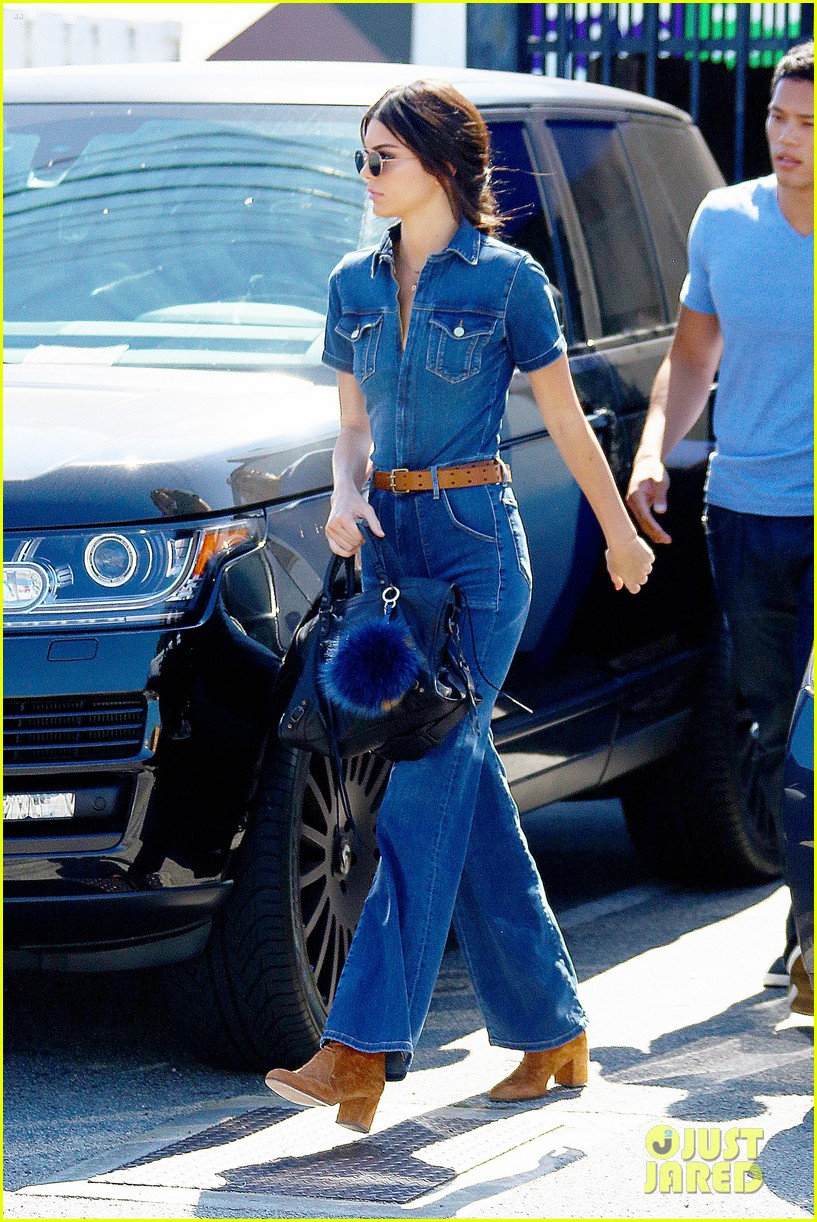 Kendall Jenner dons a denim jumpsuit as she heads to the family offices