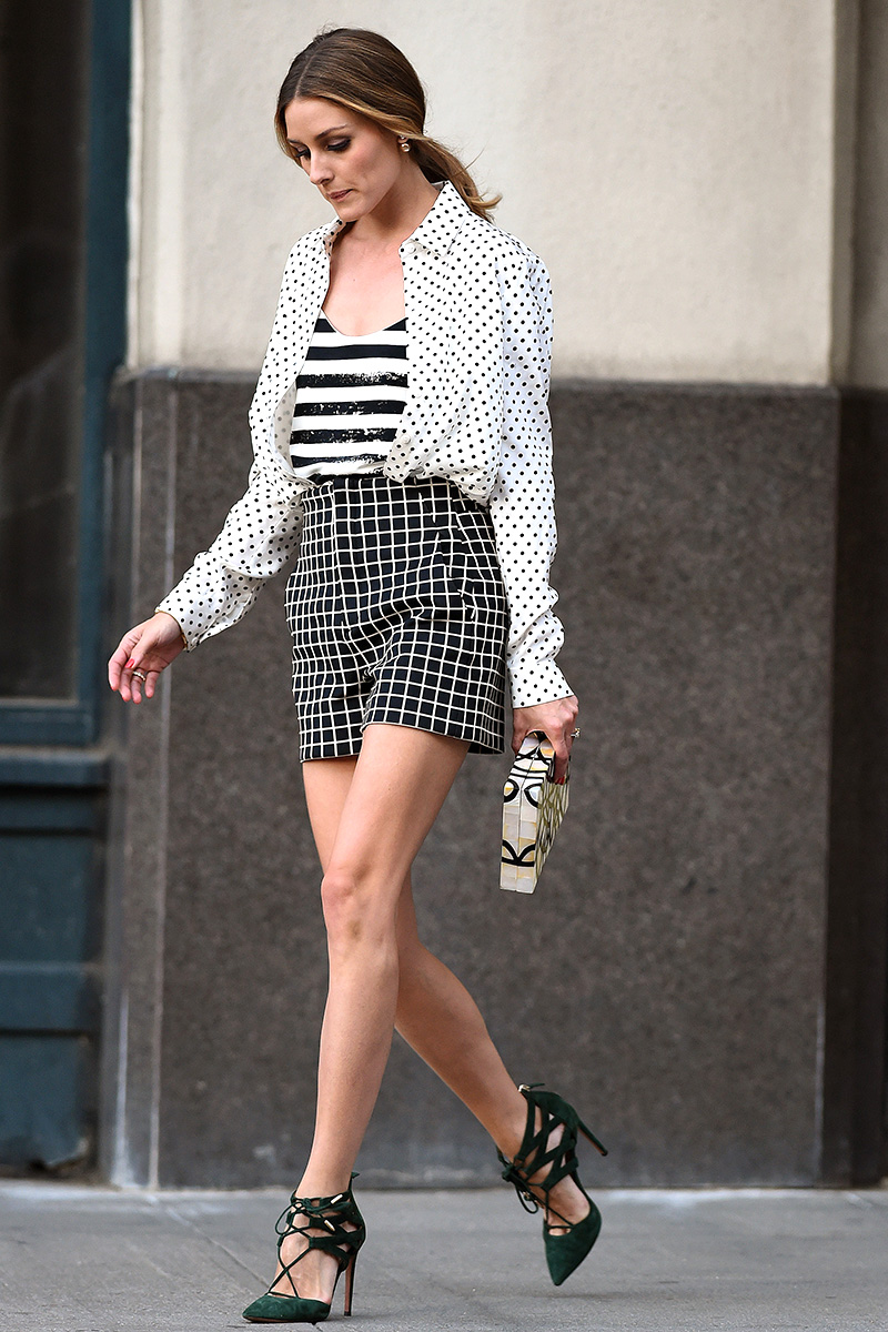 Olivia Palermo leaves her house wearing black and white patterned shorts and green suede high heels in Brooklyn, NYC