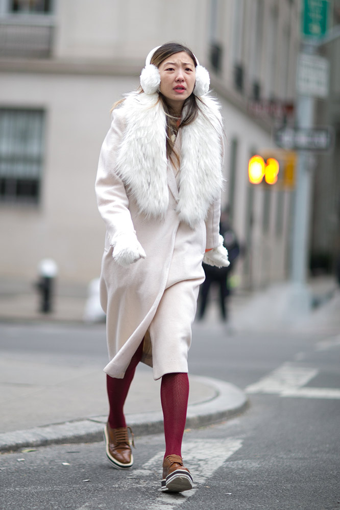 white-coat-ear-muffs-maroon-tights-street-style