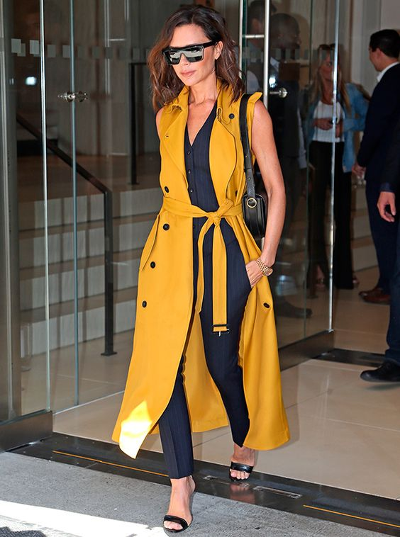 victoria Beckham style yellow sleevless trench